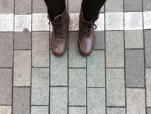 Top View of Brown Boots Shoes on Concrete Block Background Royalty Free Stock Photography
