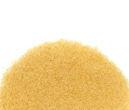 Top view of  brown cane sugar on white background Royalty Free Stock Image