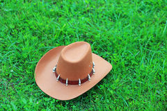 Top view of brown cowboy hat on green grass Royalty Free Stock Photography