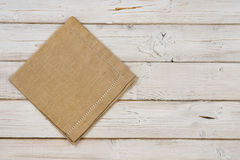Top view of brown kitchen napkin on wooden planks background stock photography