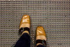 Top view of brown leather boots on the floor. Women with Leather Shoes Steps on Floor, Top view Royalty Free Stock Photos