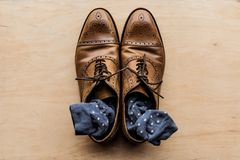 Brown male shoes with socks inside. Top view of brown male shoes with socks inside Stock Photo