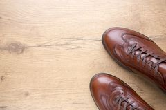 Brown men leather shoes on wooden background. Top view of Brown men leather shoes on wooden background Stock Image
