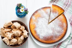 Top view: brown meringues and manna semolina pie on white wooden table Stock Photography