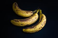 Top view of brown spotted bananas. Banana with dark black spots stock images
