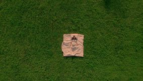 Top view brunette sleep on green grass