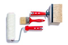 Professional house painter, work tools on a white background Stock Photos