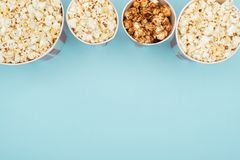Top view of buckets with popcorn in horizontal row isolated