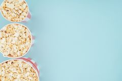 Top view of buckets with popcorn in vertical row isolated