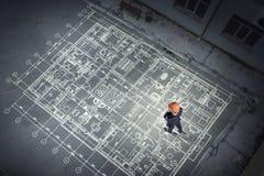 Man engineer thinking over his plan. Mixed media royalty free stock photos