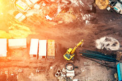 Top view of building foundation and construction site with sunset light filter Stock Photos