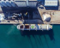 Top view of a bulker with an open empty hold. Aerial view to unload the cargo ship.  royalty free stock photography