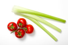 Top view of bunch of fresh tomatoes and celery sticks Stock Photos