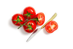 Top view of bunch of fresh tomatoes and knife Stock Images