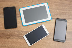 Top view of bunch of phones and tablet computer Stock Photography