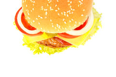 Top view of a burger with cheese, pickles, onion, tomato and sau Royalty Free Stock Images