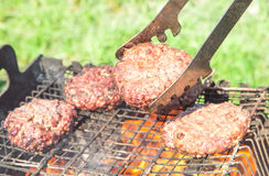 Top view of burger chops preparing on grill Royalty Free Stock Photography