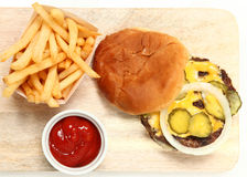 Top View Burger and Fries on Cutting Board Stock Photos