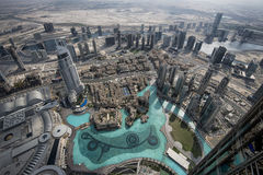 Top View from Burj Khalifa Dubai. Top view from Burj Khalifa, world's highest building in Dubai. The pond is called Dubai Fountain. Left is the Dubai Mall Stock Photo