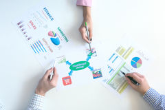 Top View of Business Meeting with Charts on White Desk Stock Photo