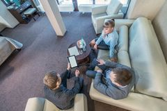 Top view on business meeting in hotel room Royalty Free Stock Image