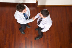 Top view of business men hand shake Royalty Free Stock Photography