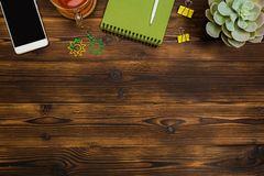 Free Top View Business Office Desk.notebook,pencil,tea Cup ,plant ,mobile Phone,paperclips On Wooden Table Background Royalty Free Stock Images - 145926919