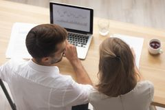 Top view business office workers talking in front of laptop. Top above view business office workers colleagues talking sitting at office desk in front of laptop royalty free stock photography