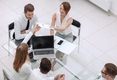 Top view.Business people discuss charts and graphs stock photo