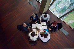 Top view of business people group throwing dociments in air Royalty Free Stock Photography
