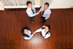 Top view of business people hand shakes Royalty Free Stock Images