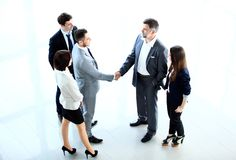 Top view of  business people shaking hands. Finishing up a meeting - Welcome to business Royalty Free Stock Images