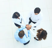 Top view of business people with their hands together in a circl Stock Image