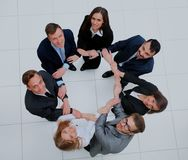 Top view of business people with their hands together in a circle. Royalty Free Stock Photography