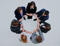 Top view of business people with their hands together in a circle. Royalty Free Stock Images