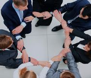 Top view of business people with their hands together in a circle. Stock Image
