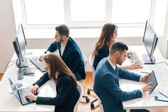 Top view of business people working on computer in modern office stock photo