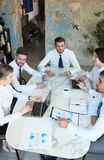 Top view of business people working together while spending time in the office. Top view of business people working together while spending  in the office royalty free stock photo