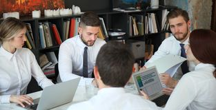 Top view of business people working together while spending time in the office.  royalty free stock photos