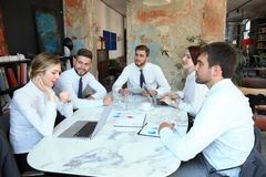 Top view of business people working together while spending time in the office.  stock photos
