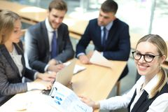 Top view of business people working together while spending time in the office.  royalty free stock image