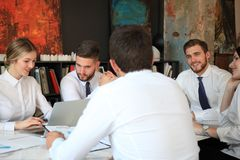 Top view of business people working together while spending time in the office.  royalty free stock photography