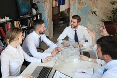 Top view of business people working together while spending time in the office.  stock images