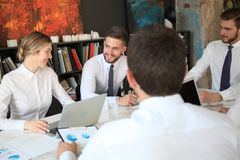 Top view of business people working together while spending time in the office.  stock photo