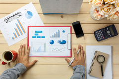 Top view business person discussing charts and graphs also noteb Royalty Free Stock Images