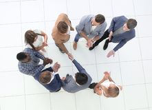 Top view.business team and handshake of business partners stock image