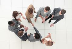Top view.business team and handshake of business partners stock images
