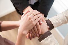 Top view of business team showing unity with hands together Royalty Free Stock Images