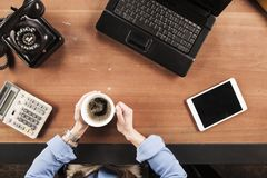 Top view, business woman drinking coffee at the desk stock images