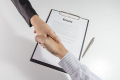 Top view of businessman and businesswoman handshake over the res Stock Images